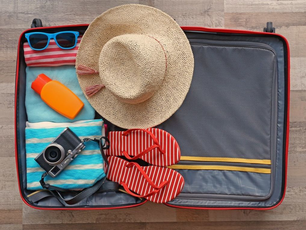 Here's how to properly plan ahead for your house and financial life for your summer trip.